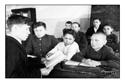 Литкружок на занятии. Руководитель кружка С.М.Кушаков читает роман Н.Лекайна. Снимок сделан для газеты =Марий коммуна= (январь 1950 год, Исменцы)